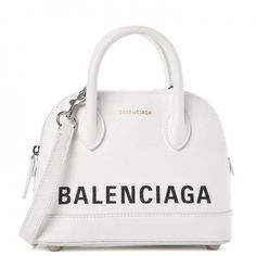 Balenciaga is a luxury fashion house founded in Spain by Cristóbal Balenciaga since a designer born in the Basque Country, Spain. The brand is now owned by the Fren Luxury Purses, Luxury Bags, Luxury Handbags, Fashion Handbags, Purses And Handbags, Fashion Bags, Runway Fashion, Vuitton Bag, Louis Vuitton