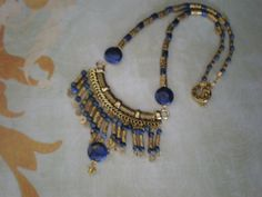 Lapis and gold toned metal  Design owned by Blue Dragonfly Designs INC, Artist is Sandi Bass