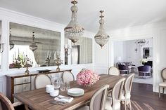 Sunset Plaza by Smith Firestone Associates - traditional dining room with wood dining table, sideboard and a pair of chandeliers