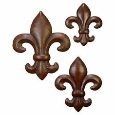 "Set of 3 metal fleur-de-lis wall accents.  Product: Small, medium and large wall décorConstruction Material: MetalColor:  BrownDimensions: Small: 12"" H x 12"" WMedium: 16"" H x 16"" WLarge: 20"" H x 20"" WCleaning and Care: Wipe with a dry cloth"