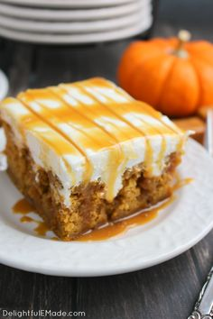 The ultimate fall dessert! A pumpkin spice cake is drizzled with caramel sauce…