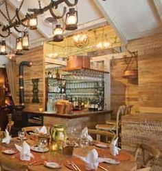 La Mangeoire- is a charming Midtown NY favorite with a farmhouse feel—antique tile floors, barn-wood ceilings, rustic beams and, on the walls, colorful paintings, old farm tools, and copper pots and pans.  #travel #dining #nyc #newyork #where