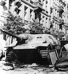 A captured German Jagdpanzer 38 Hetzer by Polish resistance fighters, used as an barricade, Warsaw, 1944.