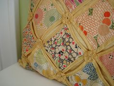 Vintage yo yo pillow from Beauty that Moves.  I think this is called Cathedral Window.  I like the use of yo-yos for embellishment