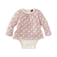 Cross Stitch Bodysuit Top   The cross-stitch-like shapes on this bodysuit are inspired by villages in the German countryside.