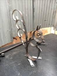 Resultado de imagen para maceteros de herreria de animales