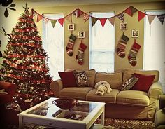 no fireplace? great idea to hang christmas stocking on the wall!
