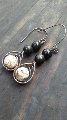 Hey, I found this really awesome Etsy listing at https://www.etsy.com/listing/490508597/black-obsidian-and-white-howlite-dangle