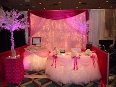 Pink and Fuchsia Booth, with Fantasy Table Skirt(R), Crystal Trees and Lighted Backdrop. www.sbdevents.com
