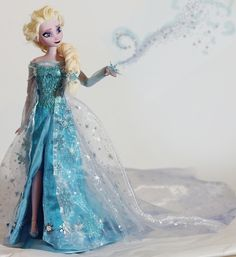 Snow Queen Elsa OOAK Doll from Disney´s movie Frozen. Face repainted with acrylic paints, hair dyed and restyled, gown handsewn with painted...