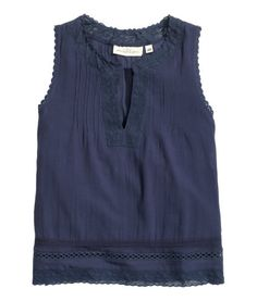 Dark blue. V-neck, sleeveless top in woven cotton fabric with pin-tucks at top, openwork embroidery, and decorative lace trim.