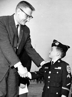 "Congressman James C. Corman congratulating a young cadet (his name tag reads: ""Notingham"") at Northridge Military Academy, circa early 1960s. James C. Corman Collection."