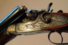 thesportinggunblog:    A 12 bore hammer gun, side by side with some quite deep engraving on the lock plates. I'd say the gun is fairly old, but not a top makers work. Interesting cross locking dolls head lock up too. Such one is very nice to own!