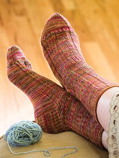 """From the magazine and book: """"A stitch pattern resembling herringbone weave helps to blend the colors of handpainted yarn; the bold ribs add stretch for a more forgiving fit. This versatile unisex pattern may well become one of the go-to sock patterns in your repertoire."""""""