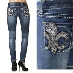 """NWOT Miss Me Skinny Jeans This women's Miss Me Fleur De Lis Skinny Jean features a fleur de lis with leather crosses, rhinestones, and stud accents on the back open pockets. Metallic stitching throughout. They feature 5 pocket styling, a zipper and button fly, and are a dark stonewash with sanding and whiskering. Imported. 93% Cotton 6% Polyester 1% Elastane. Approx 39"""" long, 7.5"""" rise, 30.5"""" inseam, 6"""" leg opening. 2.0 Miss Me Jeans Skinny"""