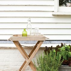I'd LOVE one of these: Butler's Tray Table - NEW          You'll wonder how you ever lived without it. A handsome rustic wooden table with a detachable tray top. So useful for ferrying and serving food if dining alfresco, and as an occasional table indoors and out. And it folds flat for storage. Not to remain outdoors. Crafted in spruce untreated wood.                                    £50
