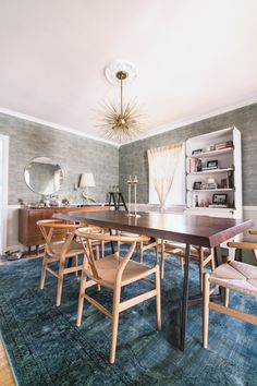 The wallpaper in the dining room actually came with the house! Michelle did a great job of making it feel fresh by mixing in eclectic, contemporary pieces, like the Wayfair dining table.