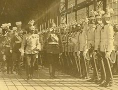 """Close-up photo of Tsar Nicholas II and the king of Saxony Friedrich-August III wearing the uniform of the Life-Guard Cuirassier regiment reviewing the guard of  honor at the Tsarskoe Selo railway station on 6 June 1914.  A very similar photograph but taken few minutes later is published in the photo album """"Nicholas II"""", page 294. Behind Nicholas II, in white fur cap, is Grand Duke Nicholas Nikolaevich Jr."""