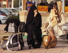 After Islamic Revolution:  Iran © Ramin Nikolas Bakhtiari...look at the girl with no believes in hijab but must obey cause obligatory,how stylish (girl in the right)