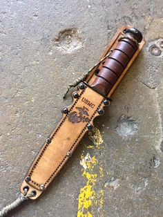 """You know RMJ Tactical for their tomahawks but, judging by the looks of their new Ka-Bar sheath, you may know them for leather working soon. RMJ Tactical says that the new sheath has a """"Vintag… Leather Art, Custom Leather, Leather Tooling, Gun Holster, Leather Holster, Rmj Tactical, Ka Bar Knives, Railroad Spikes, Combat Knives"""