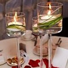 ....with Orchid for dinner tables (not so much grass)  Also, Reception Table will be just like this but in (3-5)multi level cylinder glass