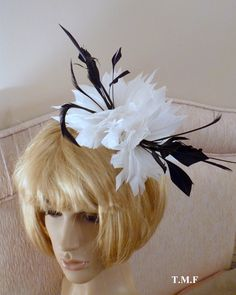 White and black feather fascinator