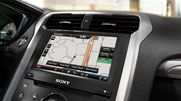 The available voice-activated Navigation System. 2013 Ford Fusion