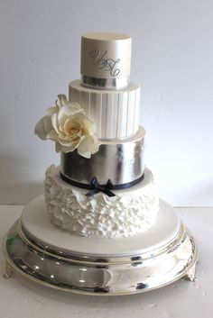 White and Luster Fondant Tiers with Gumpaste Flowers.  --Faye Cahill Cake Design