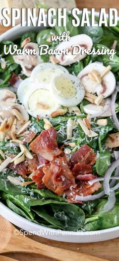 Warm spinach salad is a fun twist on a classic spinach salad recipe! Crisp spinach, mushrooms, bacon and parmesan are tossed in a warm dressing made from the bacon drippings! Toss on some toasted almonds and it is complete! recipes for dinner Warm Spinach Salads, Spinach Salad Recipes, Bacon Salad, Spinach Salad With Bacon, Spinach Dressing Recipe, Warm Salad Recipes, Warm Bacon Dressing, Parmesan, Clean Eating