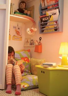 Closet converted into a kid's reading nook.
