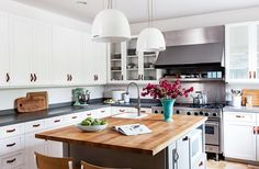 L.A.-based writer Christine Lennon's stunning kitchen is the perfect reminder that differentiating details can go a long way to personalize any kitchen. The unique leather drawer pulls add an extra dash of style, as do the minimalist pendants and the cork flooring.