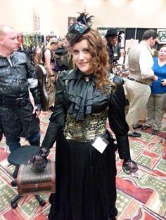 Miss Bonnie Jensen wearing our Long Black Satin Bustle Skirt and Satin Ladies Cravat Blouse - So pretty!