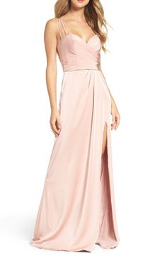Leave them blushing in a pastel pink gown that shimmers through the pleat-sculpted bodice and statement back.