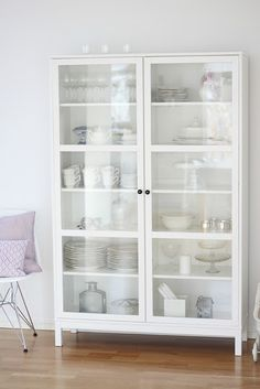 i like this style of curio cabinet for dishes etc