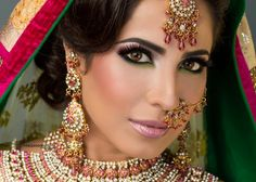 Indian style ethnic MakeUp Artist: Tamanna Roashan did this stunning face. Pink lips, many jewelry, dark eyes and of course black hair!