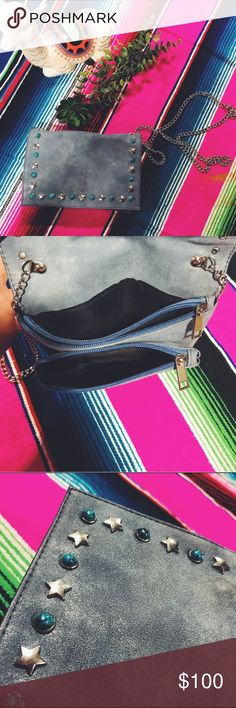 Gray Leather Cross Body Purse 💙 Gray Leather Cross Body Bag with Turquoise and Stars In great condition Has three compartments, two with zippers One of my favorite accessories in my closet 😍  Valentino Garavani Inspired, no tags or stamps.  Feels like genuine leathers & quality metal, but this is a second hand bag. Offers are welcome 👍🏼  ✨ I SHIP WITHIN 24 HOURS 💕TOP RATED POSHER 🌵 FREE GIFT WITH EVERY PURCHASE  ✌🏼BUNDLE TO SAVE 20% Valentino Garavani Bags Crossbody Bags