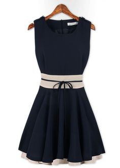 Like: cute, color-blocking at waist, black/white contrast (Empire-Waist A Line Mini Dress)