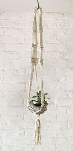 Hand made Macrame plant hanger.  100% cotton rope  Dimensions: L: 42