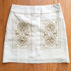 New Beaded Floreat for Anthropologie Skirt Gorgeous, gold metallic Anthro skirt by Floreat. Beautiful beaded design on front. This skirt also has pockets! Material has a shimmer to it. Shell: 63% rayon, 26% rayon, 11% lurex. Lining: 100% cotton Anthropologie Skirts