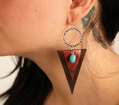 I love leather and turquoise together, don't you? How beautiful is this pair of earrings! These come on sterling silver hooks as well. :)  https://www.etsy.com/listing/491747217/leather-earrings-triangle-earrings?ref=shop_home_feat_4  #mismoco #leatherearrings #leatherjewelry #leatheraccessories #leatherearring #turquoiseearrings #turquoiseearring #cuteaf #handmade #handmadejewelry #handmadeearrings #silverearrings #dangleearrings #swag #etsyshop #etsyfinds