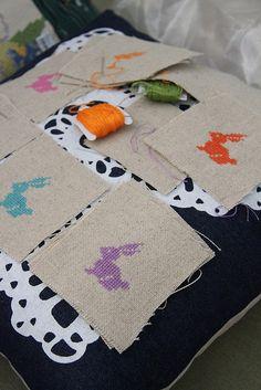 Cross-stitched rabbits.