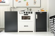 Brio stove and sink in black and white play kitchen