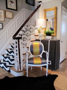 More black and white, because like animal print, it's kind of an ultimate neutral to work with! This staircase is lovely with the black handrails and white ...