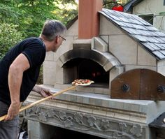 Handmade pizza oven and first pizza.  All the work was worth it!