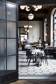 Restaurant details at the Reynard in the Wythe Hotel. Floor mosaics, classic café chairs & marble café tables, with industrial lights. Restaurant Design, Café Restaurant, Industrial Restaurant, Classic Restaurant, Restaurant Seating, Luxury Restaurant, Restaurant Furniture, Cafe Bar, Cafe Design