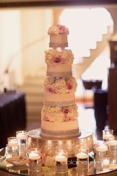 "Maybe you desire a classy, elegant event.  Large or small, weddings, even in a barn, can very much be the black tie affair.  Because of this, we also wanted to show you some fancier, more ""show-stopping"" wedding cakes. This one is by Zingerman's Bakehouse in Ann Arbor, Michigan."