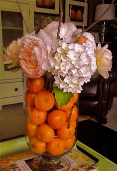 i love fruit and flower arrangements.... @Alison McGee This would be pretty outside at your wedding!