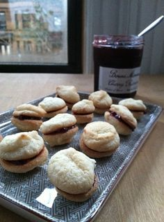 These macaroons are a distant relative of the recipe on the Odense Almond Paste box. Lemon zest and vanilla, and cherry jam in the middle, make for a sweet treat perfect for Valentines Day.