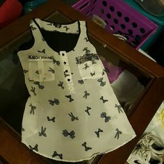 Bows and sequins top Super cute and flowy Rue 21 Tops Blouses