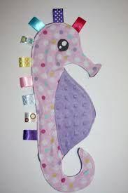 Image result for taggie blanket